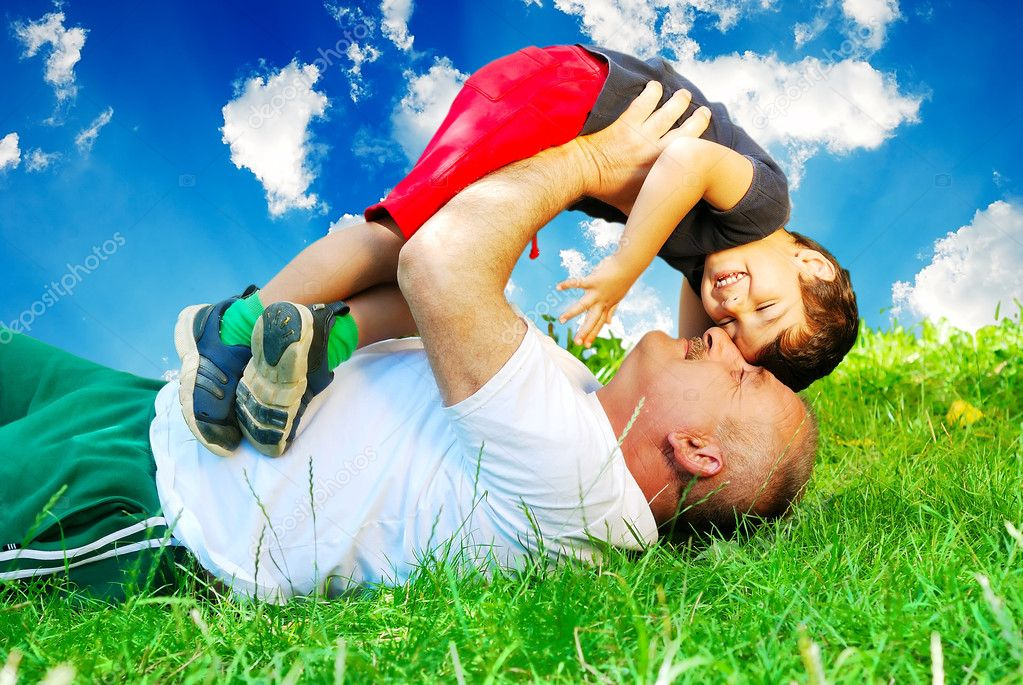 Happy parent and little boy