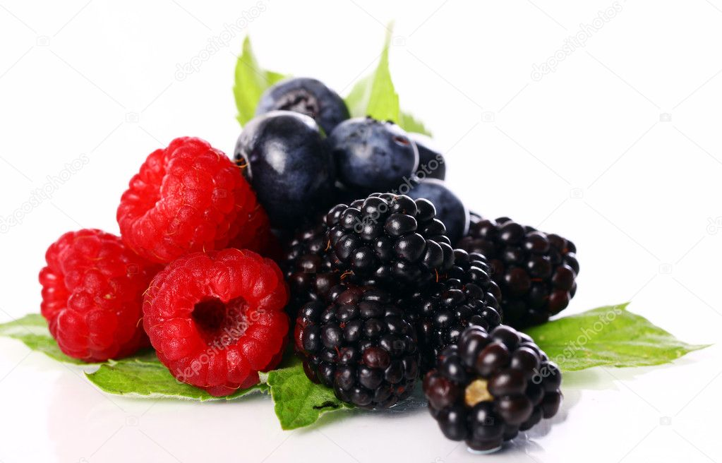 Fresh forest berries over white background