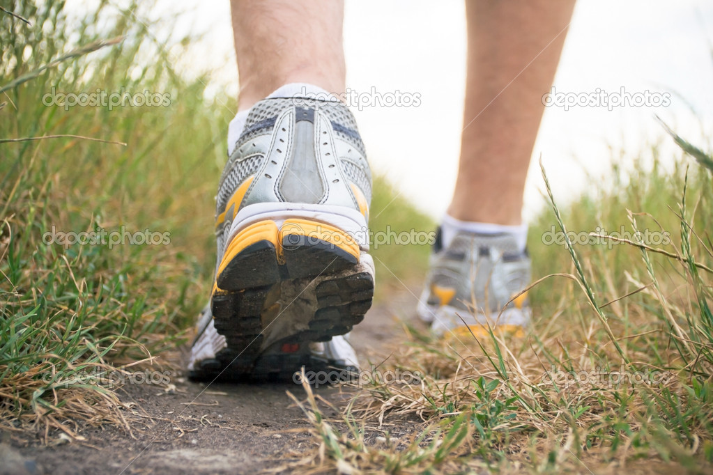 Walking man on trail