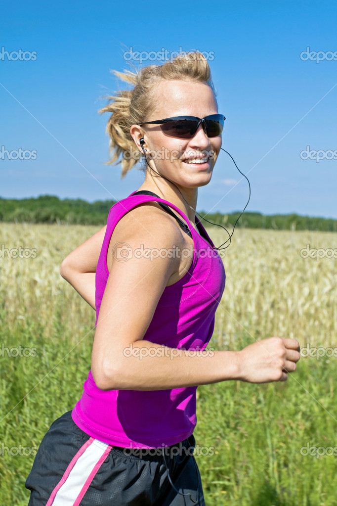 Running woman in summer nature, motion blur