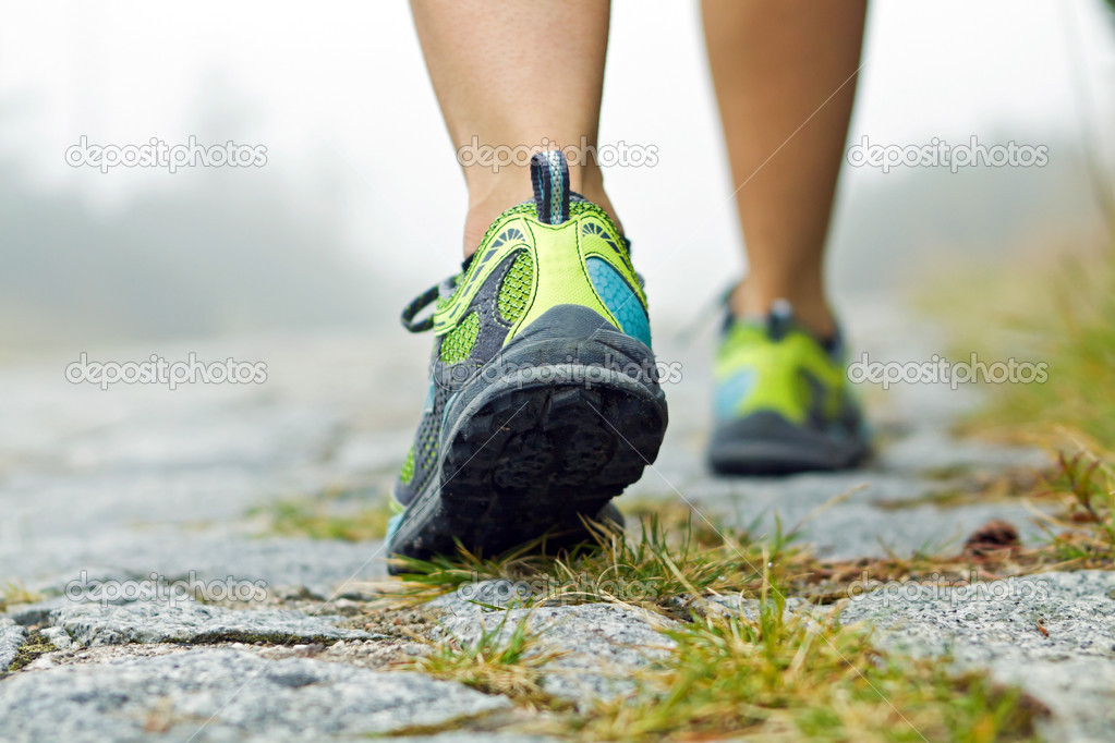 Walking exercise, sport shoes and legs