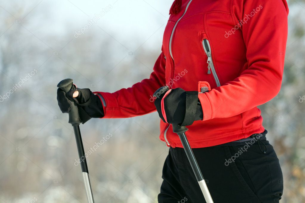 Woman nordic walking in winter