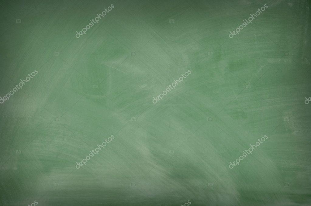 Green chalkboard with eraser marks