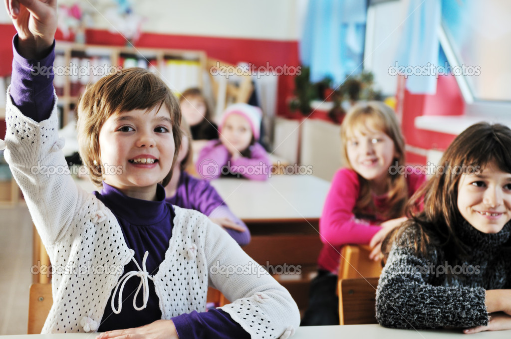 Happy kids with teacher in school classroom — Stock Photo ...