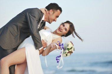 Romantic beach wedding at sunset
