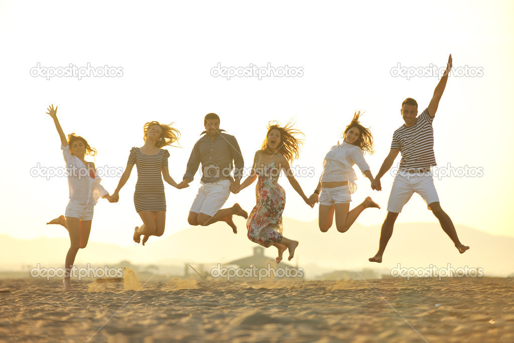 Happy young group have fun on beach