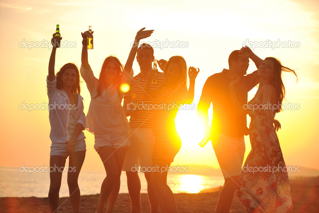 Group of young enjoy summer party at the beach