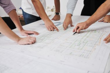 Team of architects on construciton site