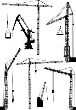 set of seven building cranes