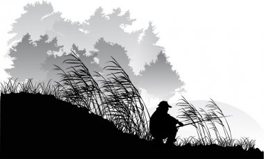 fisherman silhouette near forest lake