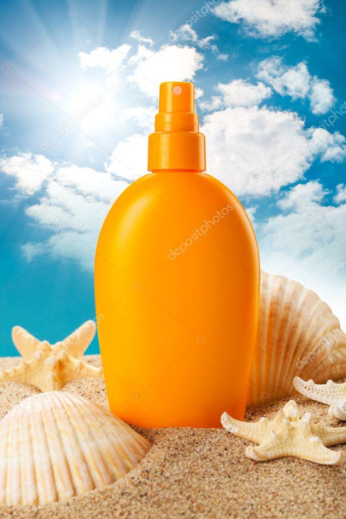Suntan oil and sea shells