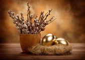 Photo Easter - Golden eggs in the nest