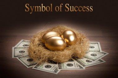 Symbol of Success - three golden eggs stock vector