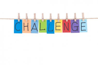 Challenge, words hang by wooden peg