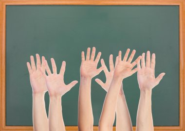 Many hands and blank blackboard