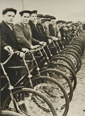 Men on bicycles, old photograph
