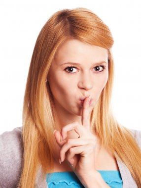 Woman with finger near lips