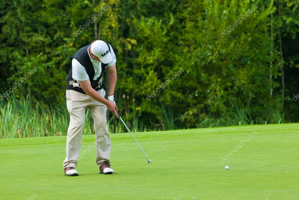 Golfer finishes his swing