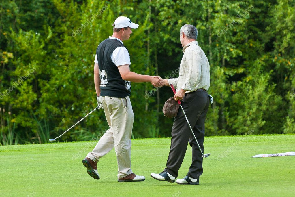 Two Golfers shake hands at Country Club
