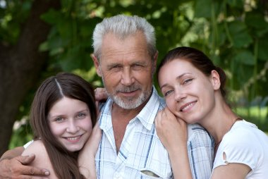 Happy grandfather, daughte and granddaughter outdoor