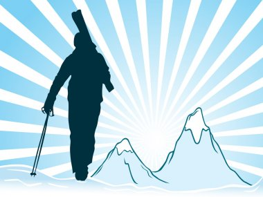 Silhouettes of skiers