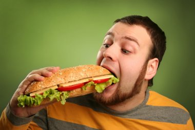 Funny guy eating hamburger on green background stock vector
