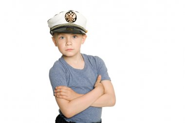Cute boy in a sea cap