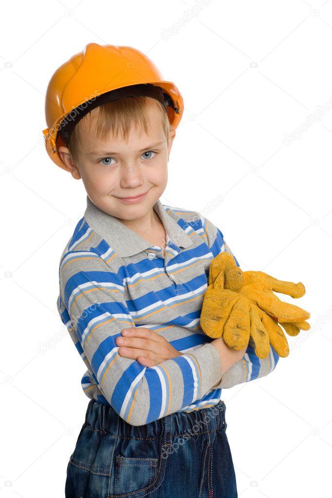 Joyful boy in the construction helmet