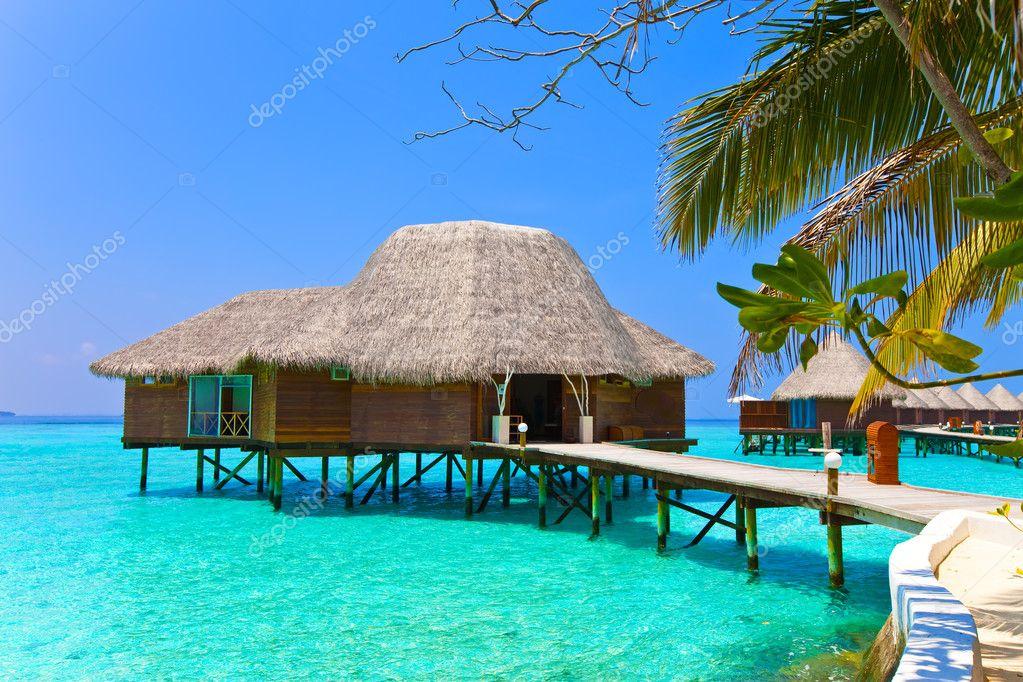 Island in ocean, overwater villa.Maldives.