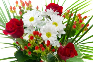 Bright bouquet with chamomiles and roses