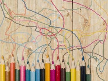 Colour pencils on a wooden plank stock vector