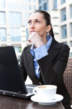 Young business woman thinking