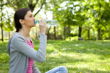 Healthy woman drinking water