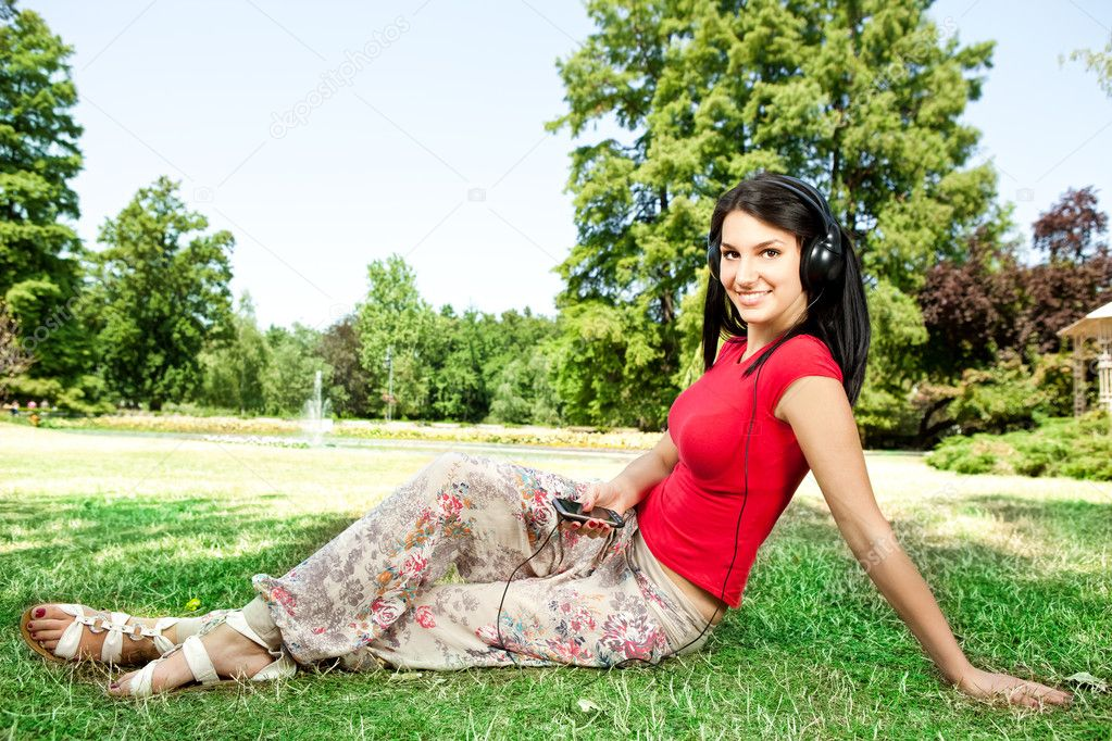 Girl with headphones in the park