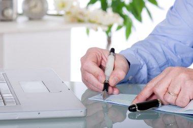 Writing check businnes concept