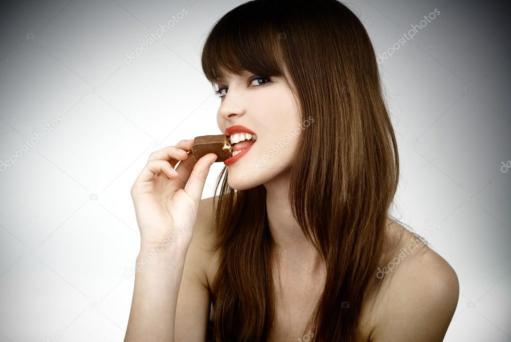 Sexy girl eating chocolate