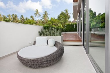 View of nice big chair on the balcony of summer villa