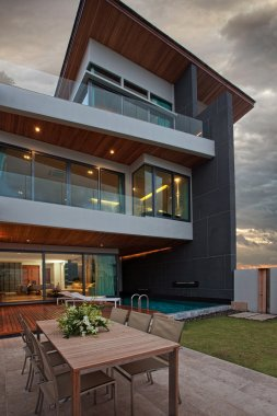 CView of nice modern villa in summer after sunset environment