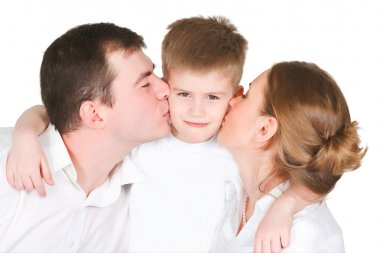 Parents kiss the son