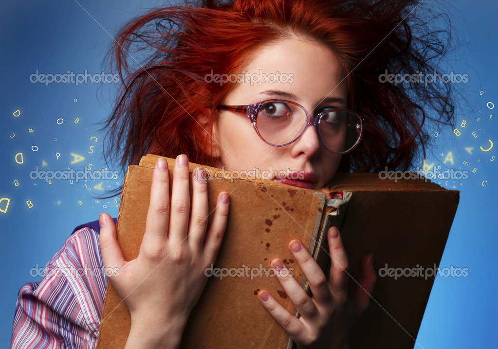 Young wizard girl with old magic book and letters.