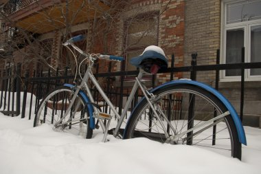 Bicycle in snow heavy winter