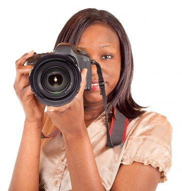 A female african american is photographing you. stock vector