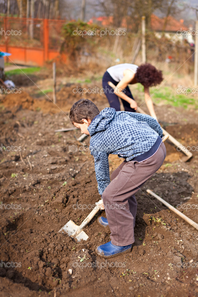 Mother and son working the land