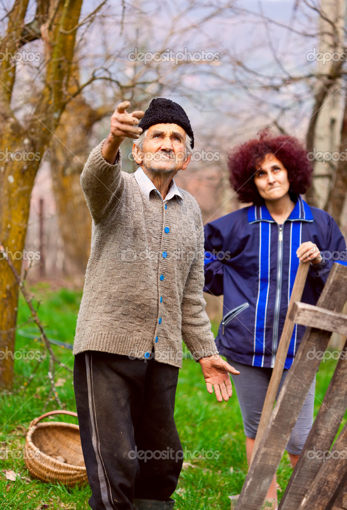 Senior farmer talking to his daughter