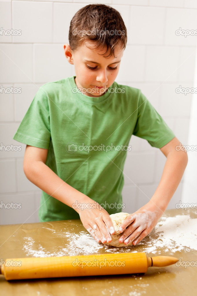 Boy preparing cookies or bread