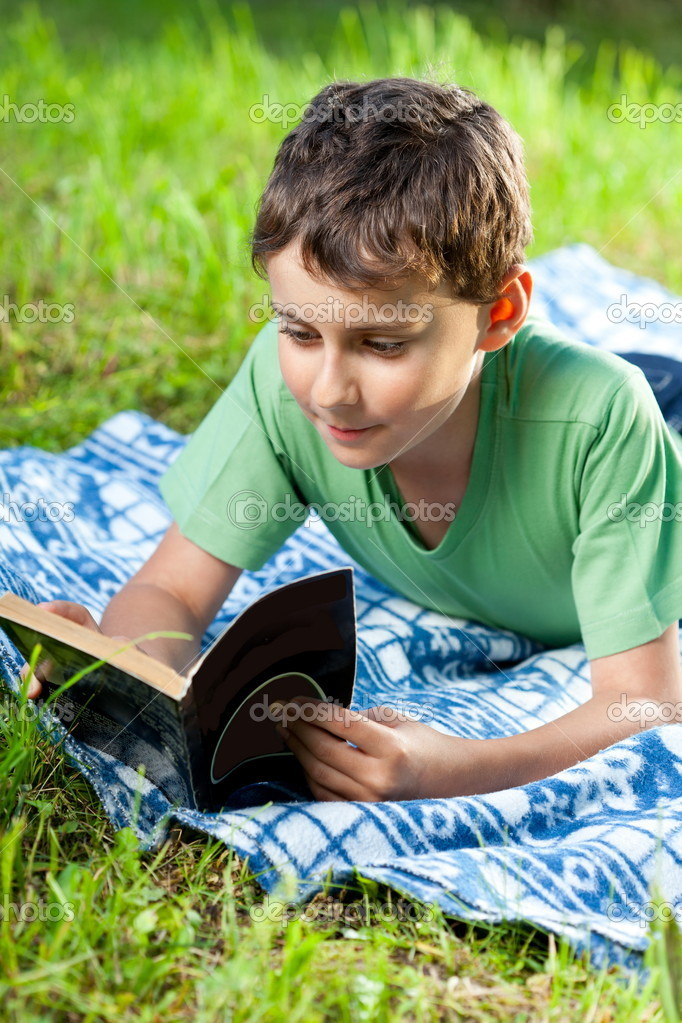 Child reading a book outdoor