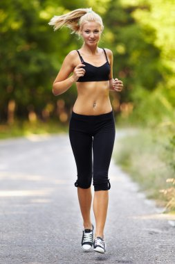 Young blond woman running