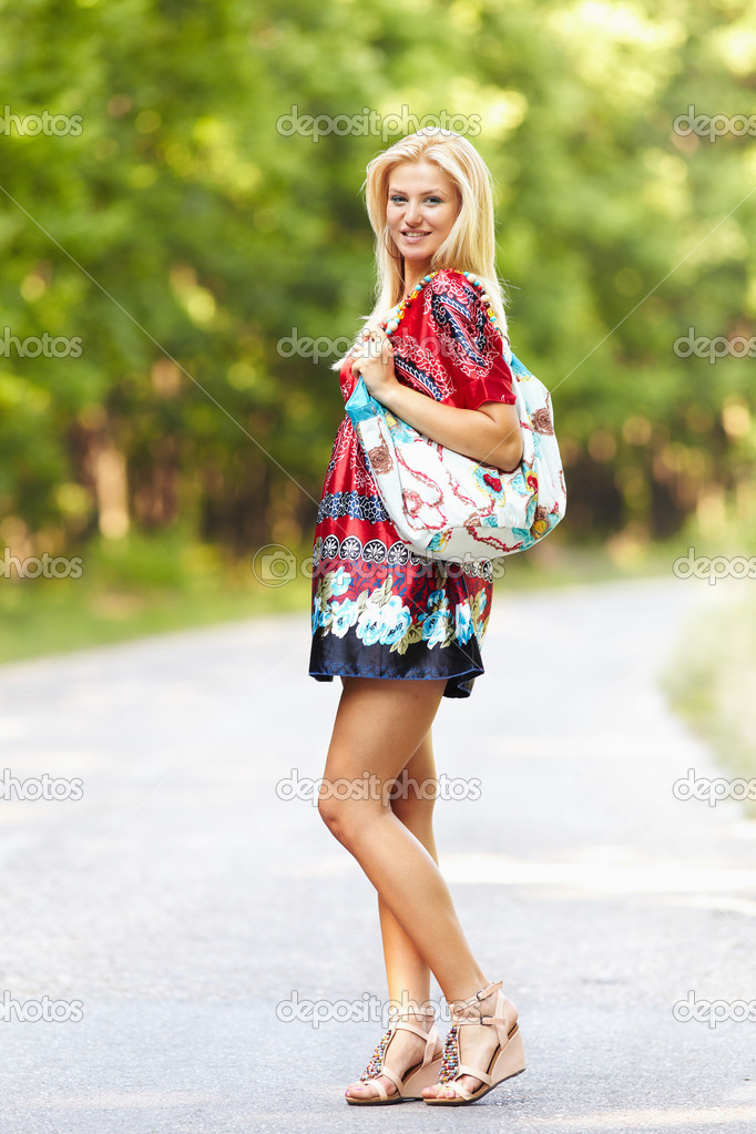 Young blond woman outdoor on a street