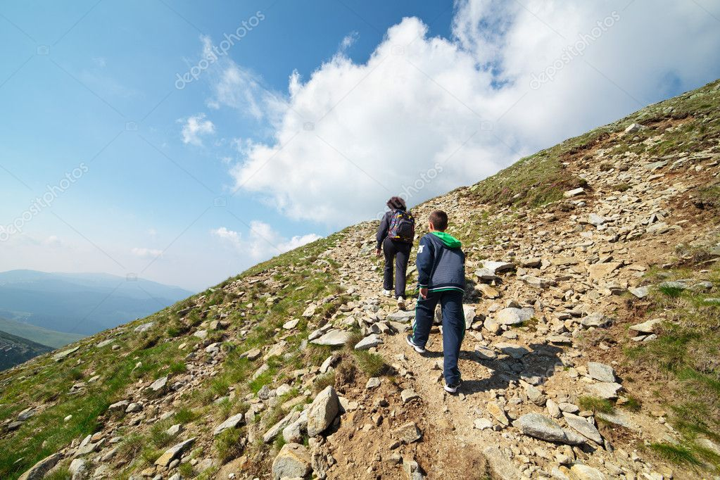 Tourists hiking on Iezer peak in Parang mountains, Romania