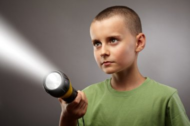 Child with flashlight concept shot